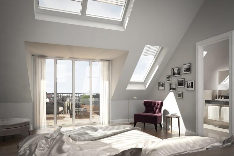 Wohnen mit Penthaus-Feeling: Auf der großzügigen zweiten Dachgeschossebene genießen Sie den unverbauten Ausblick über die Dächer der Stadt